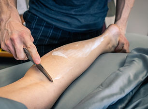 Physical therapy of a woman's calf being
