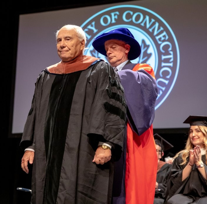 Former Avon resident, Richard Lublin receives an Honorary Doctor of Fine Arts, at the May 11 commencement ceremony. (G.J. McCarthy / UConn Foundation)
