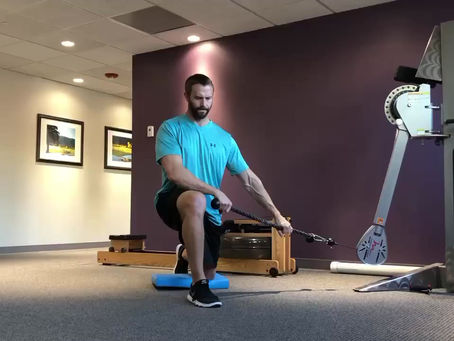 Half-Kneeling Low to High Cable Chop w/Overhead Lift