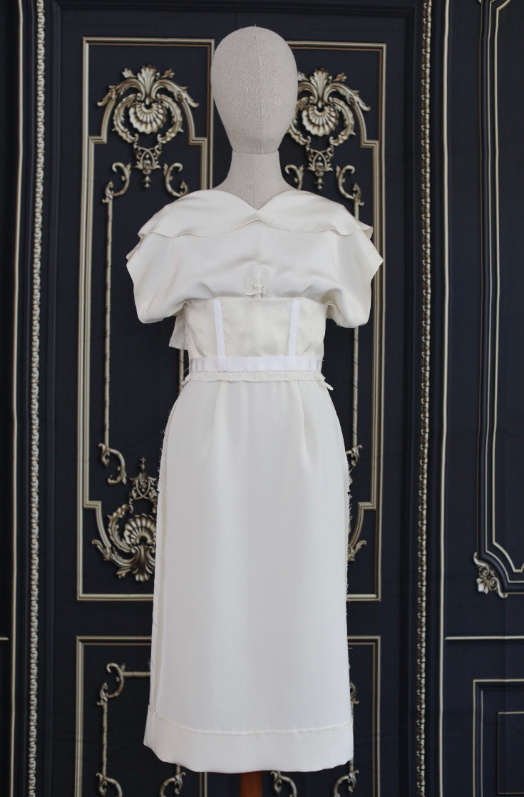 1958 Dress designed by Madame Gres, from pattern number Vogue 1411. Short sleeve ivory day dress, or courthouse wedding dress with front bow.