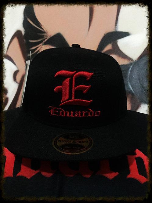 Boné Eduardo preto/bordado vermelho