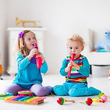 bigstock-Boy-And-Girl-Playing-Flute-1111