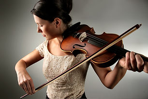 bigstock--young-woman-playing-the-violi-