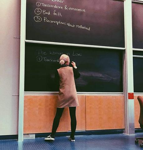 Celia writing on the board