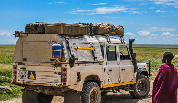The Masai and the Land Rover and the Ser