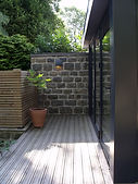 Glazed wall and decking steps