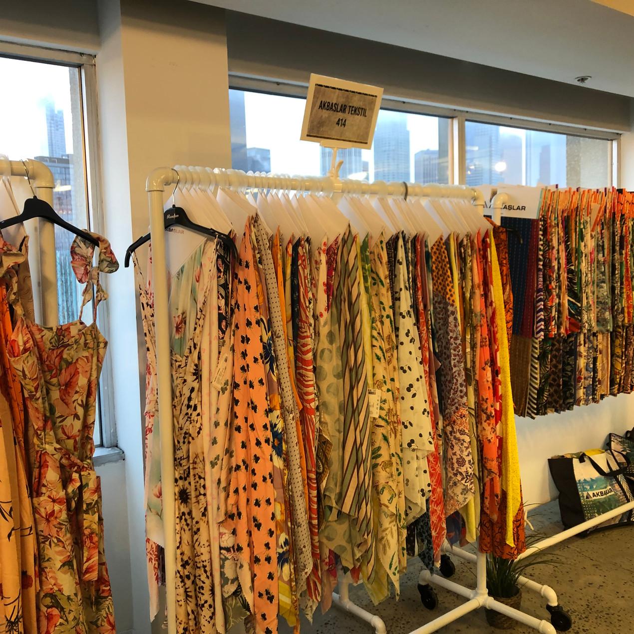 garment rack of fabrics and prints