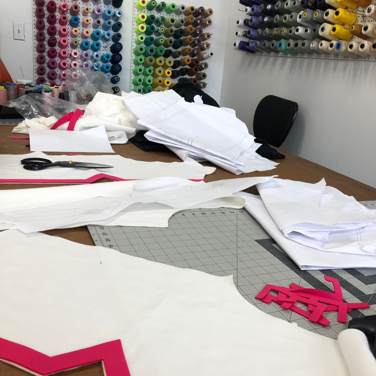 sample room table with patterns and thread