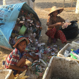 Children from a very young age assist with the sorting of recyclable items to onsell.