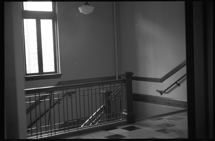 Black and white photo of stairwell.