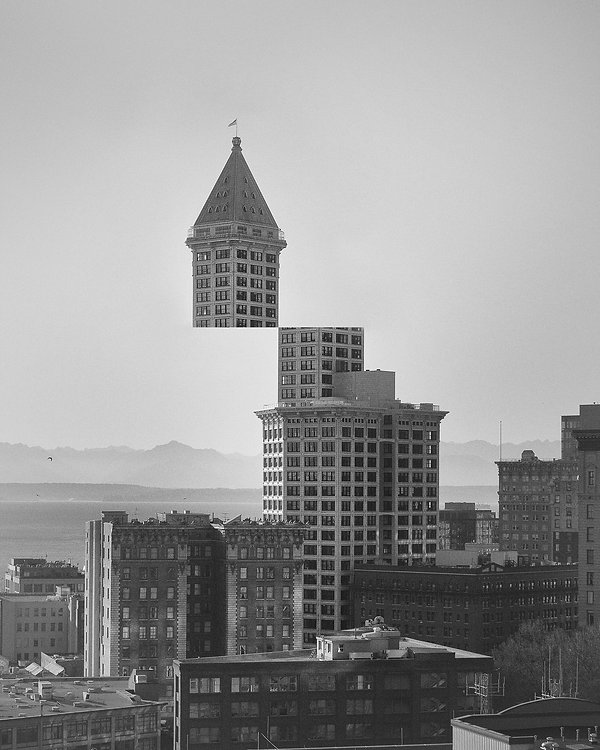 Black and white photograph of Seattle's Smith Tower. Top half of building is cut off an moved to the left as if hovering.