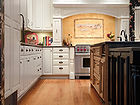 StarMark Kitchen cabinets white and cherry mixed design