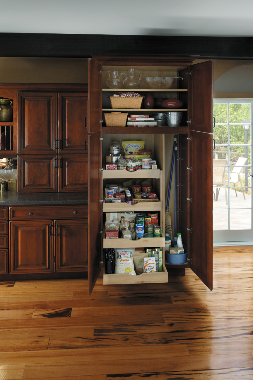 Pantry with Roll-Out Shelves and Broom Storage