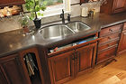 Yorktown Kitchen Cabinets cherry sink base cabinet with tip out tray