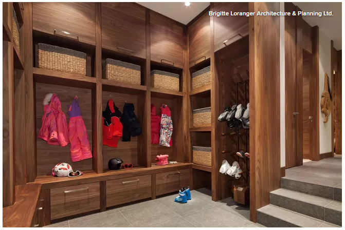 High performance mudroom featuring walnut cabinets and a boot dryer