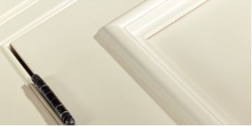 White inset cabinet with exposed finial hinge