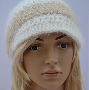 Crocheted hat made from yarn spun from an american eskimo dog