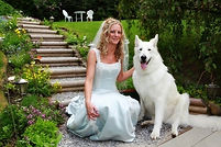 Great Pyrenese Shepherd mix dog with woman in wedding dress