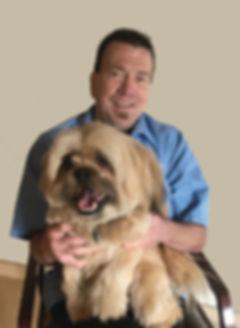 Dr. Brancel with his dog, Tashi