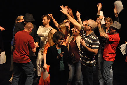 TNC staff and members celebrate after Big Gig dress rehearsal