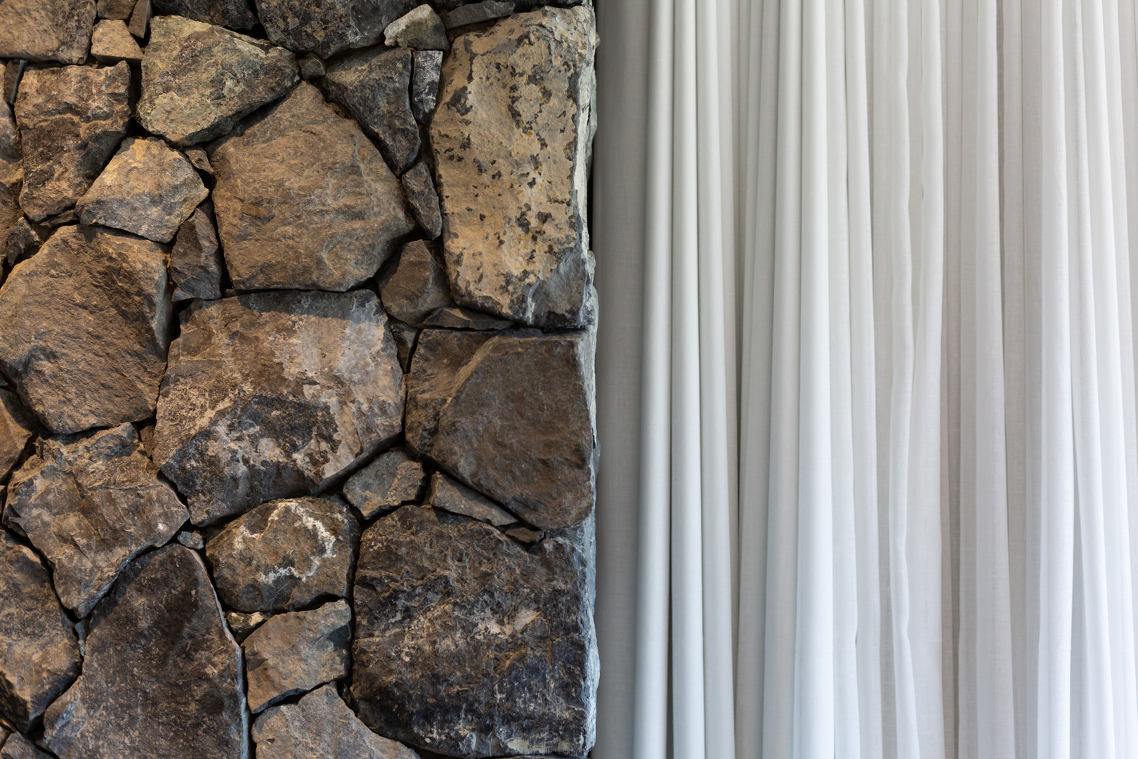 Interior rock wall and curtains
