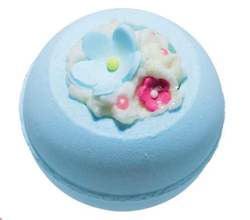 Blue bath bomb with flowers on the top