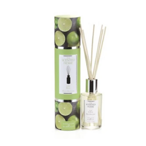 Green patterned tube next to bottle with reed diffusers