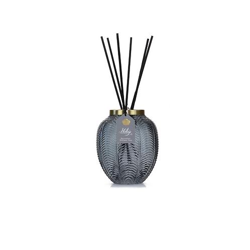 Grey vase with black reeds