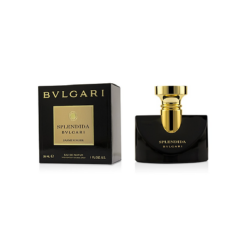 Black perfume bottle next to a black box with a gold label