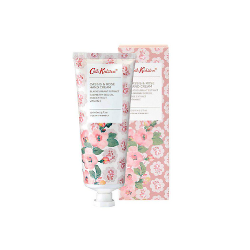 Large floral hand cream tube in front of a floral box