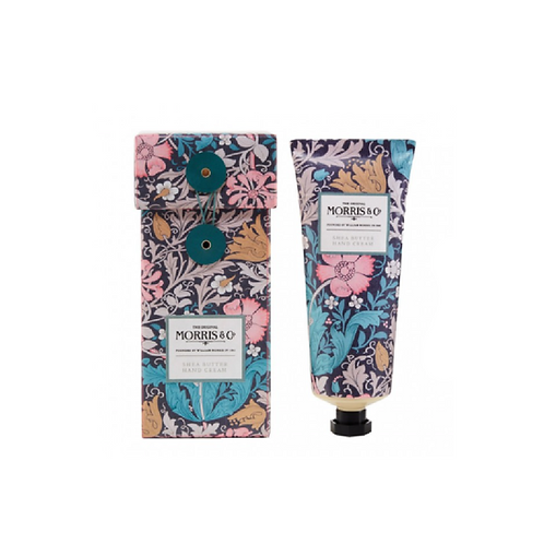 Patterned box with a tube of hand cream beside it