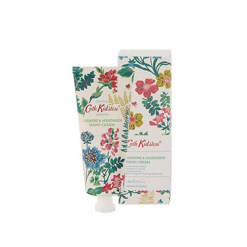 Large hand cream tube next to a floral box.