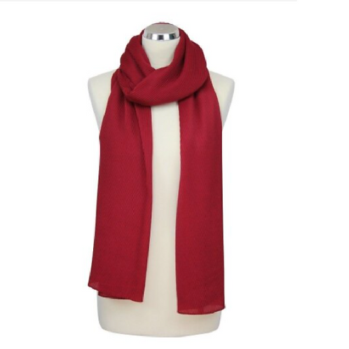 Red pleated scarf on mannequin