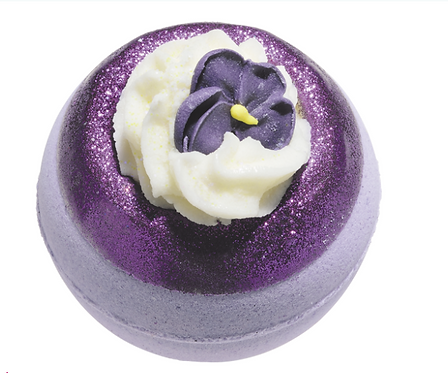 Purple bath bomb with a purple flower on the top
