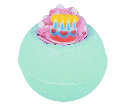 Green bath bomb with a birthday cake on the top