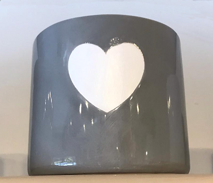 Grey plant pot with white heart