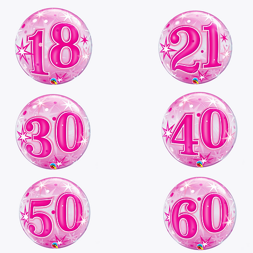 Round pink bubble balloons with numbers 18, 21, 30, 40, 50, 60 on the front
