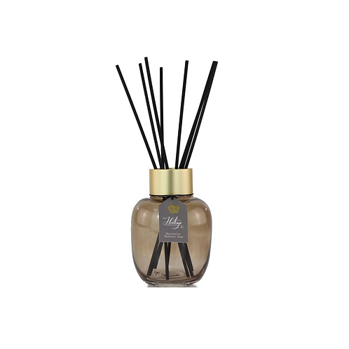 amber vase with black reeds