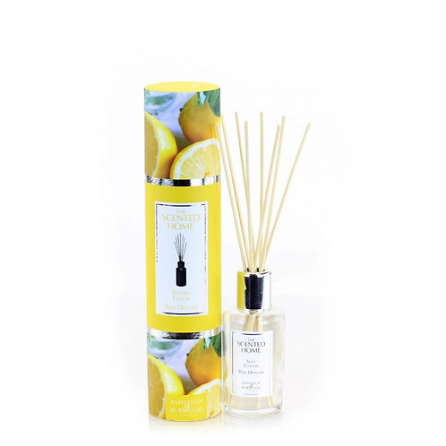 Yellow patterned tube next to bottle with reed diffusers