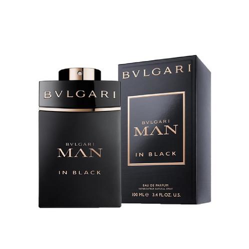 Black bottle of fragrance in front of a black box