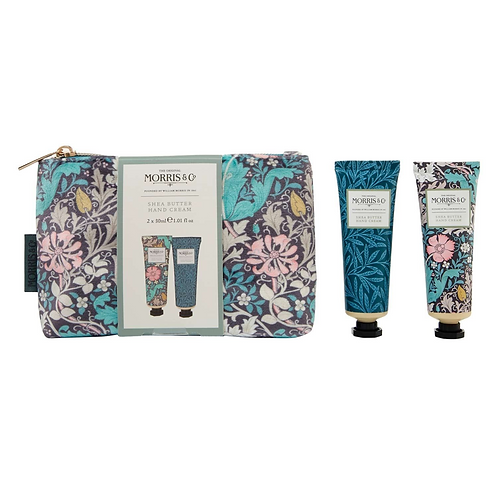 A patterned makeup bag next to two tubes of hand cream