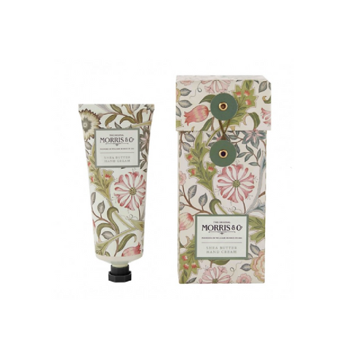 Floral patterned tube of hand cream next to a patterned box