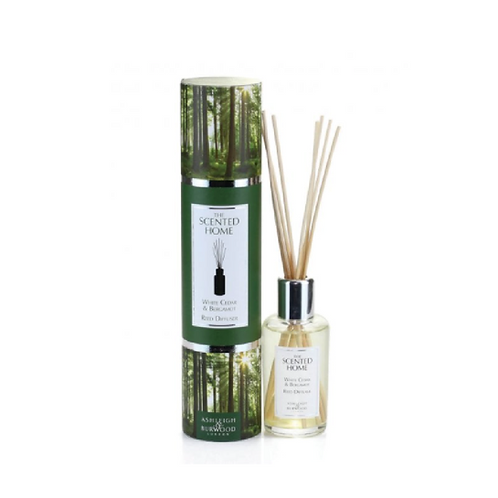 forest patterned tube next to bottle with reed diffusers
