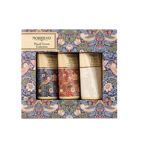 Trio of hand cream tubes visible in a patterned box
