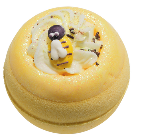 Yellow bath bomb with a bee on the top