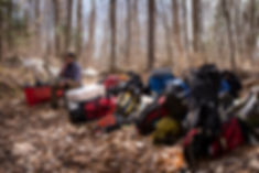 Mark Vlaskamp takes a break during a long portage on the Northern Forest Canoe Trail.
