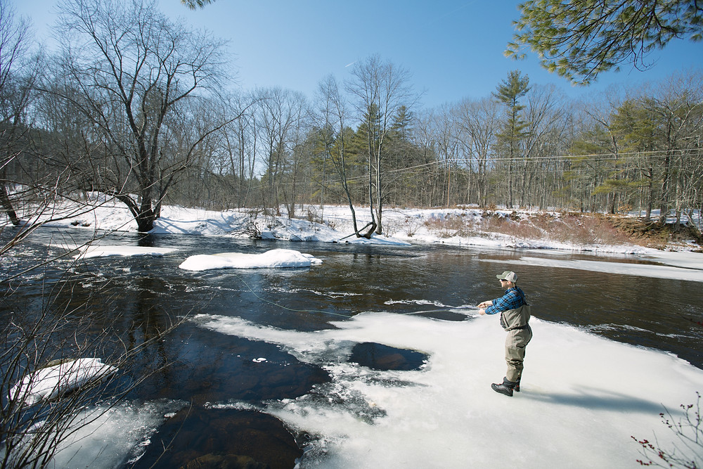 Postfly's Brian Runnals stands on the ice to send out a few casts.
