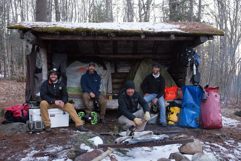(From left) Ben Duchesney, Mark Vlaskamp, Rex DeGuzman and Robert Field warm up by the campfire in the Adirondacks.