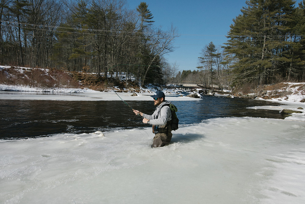 Author Ben Duchesney fly fishing from the ice.