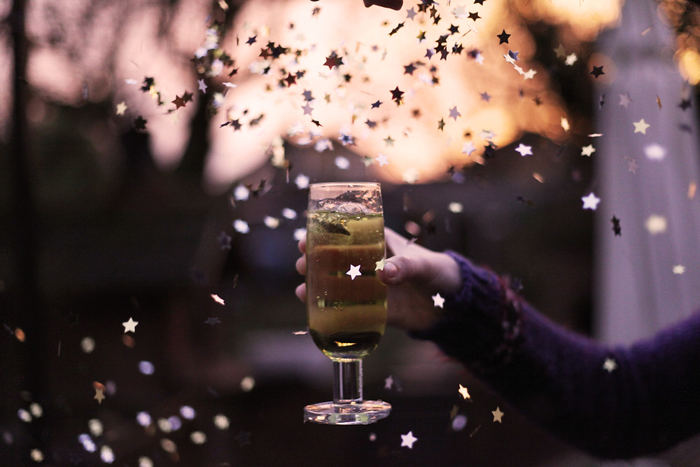 cheers. Drink with confetti at holiday party